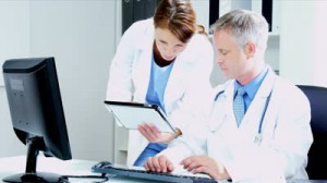 stock-footage-caucasian-male-female-medical-team-members-using-tablet-computer-hospital-rooms-shot-on-red-epic